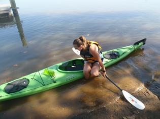 woman getting out of kayak gracefully